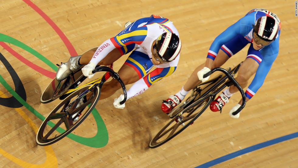 Hersony Canelon of Venezuela, left, races against Pavel Kelemen of Czech Republic during the men's sprint track cycling 1/16 finals.