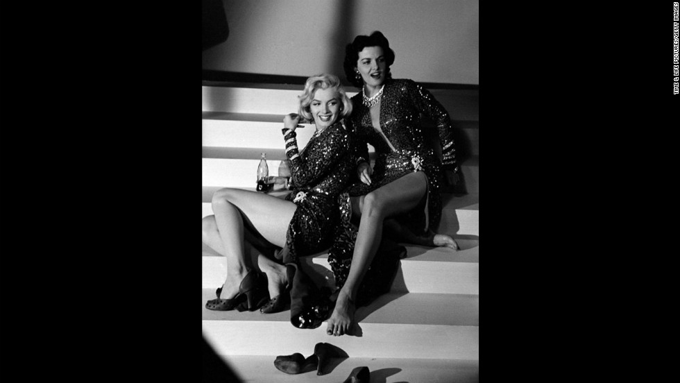 "Marilyn Monroe and Jane Russell on the set of 1953's ""Gentlemen Prefer Blondes."" See more from this series at <a href=""http://life.time.com/icons/life-on-the-set-of-gentlemen-prefer-blondes/"" target=""_blank"">LIFE.com</a>."