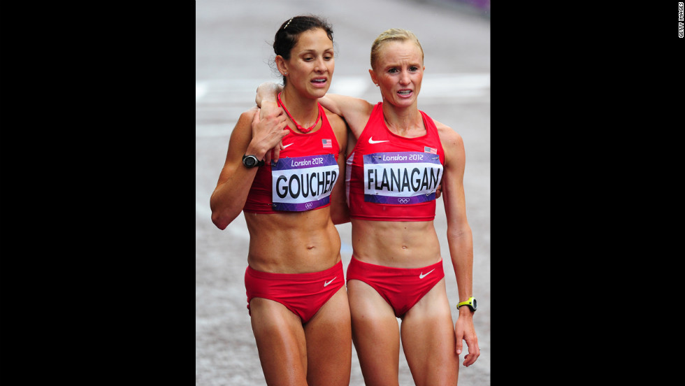 Kara Goucher, left, and Shalane Flanagan of the United States support each other after completing the women's marathon.
