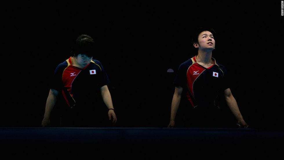 Seiya Kishikawa and Koki Niwa of Japan compose themselves during their men's team table tennis quarterfinal match against the team from Hong Kong.