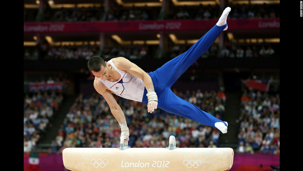 Cyril Tommasone of France performs his routine in the artistic gymnastics men's pommel horse final.