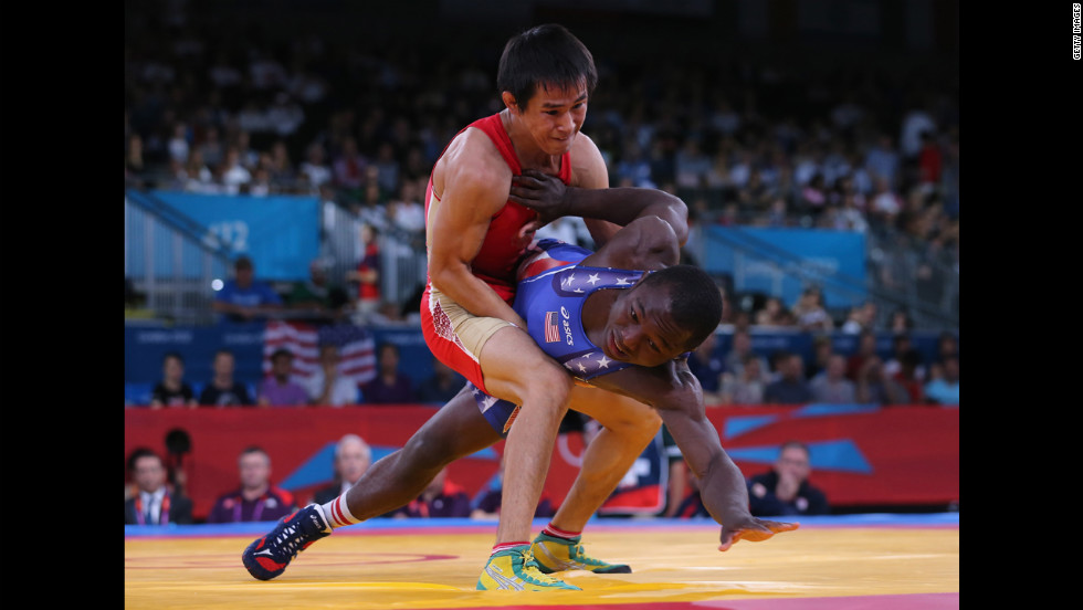Mingiyan Semenov, left, of Russia grapples with Spenser Thomas Mango of the United States during the men's Greco-Roman 55-kilogram wrestling qualification matches.
