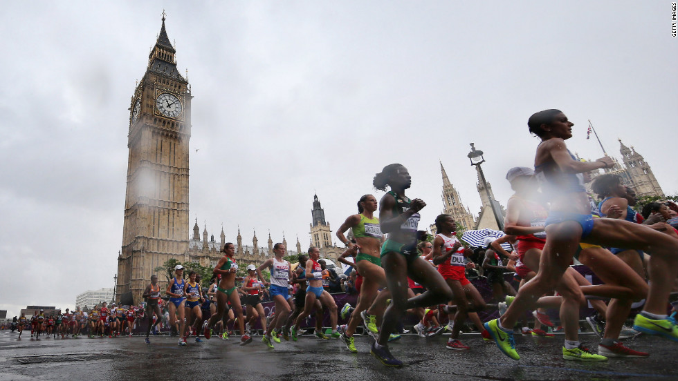 Competitors take part in the women's marathon event as rain falls on Day 9 of the London 2012 Olympics.