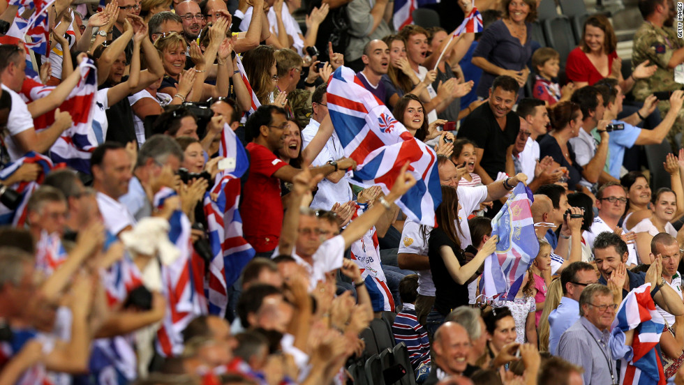 Spectators cheer from the stands during track cycling events at London Velopark in east London.