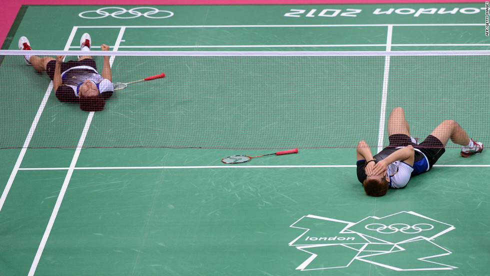South Korea's Lee Yong Dae, left, and Chung Jae Sung celebrate their victory over the Malaysian team during the bronze medal men's doubles badminton match.