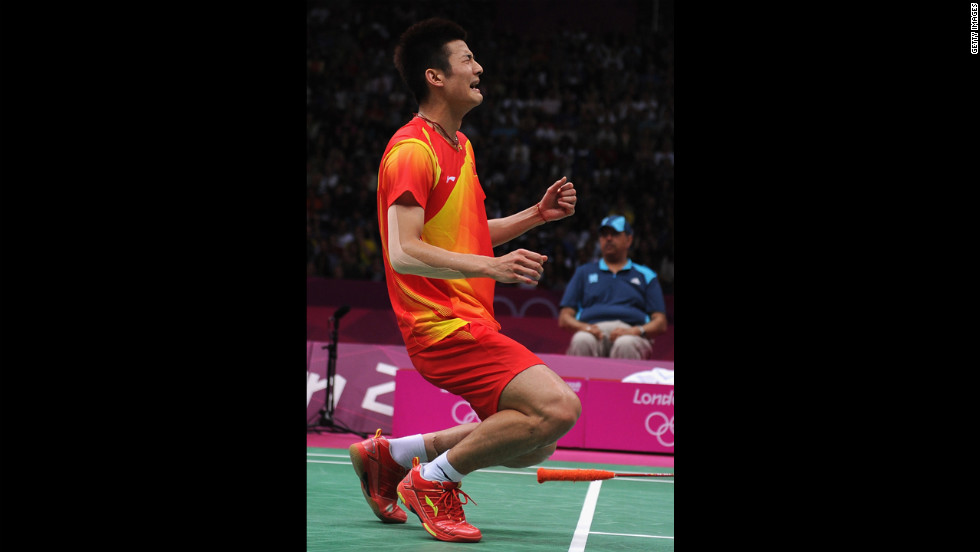 Long Chen of China celebrates winning the bronze medal in the men's singles badminton event, beating Hyun Il Lee of South Korea.
