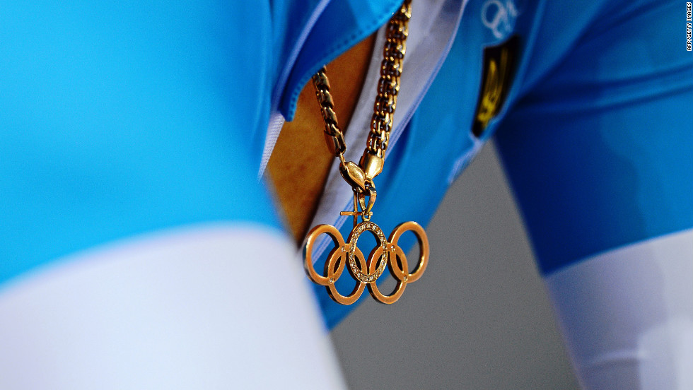 Lyubov Sulika of Ukraine wears an Olympic rings pendant as she prepares for a women's sprint qualifying track cycling event.