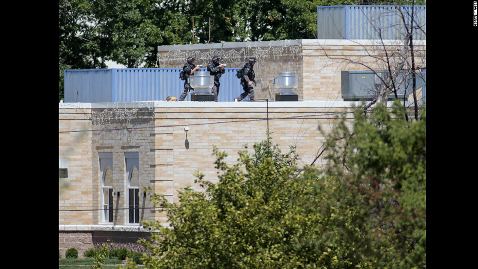 SWAT officers surround a Sikh temple in Oak Creek, Wisconsin, where a gunman whom authorities identified as Wade Michael Page, 40, stormed the building and opened fire on August 5. The incident left six people and the gunman dead.