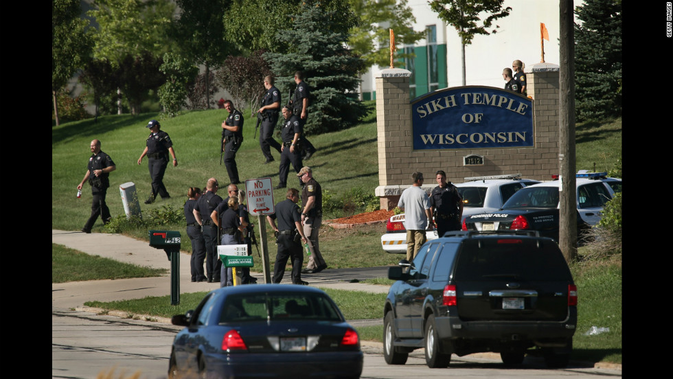 Police work outside the entrance to the temple, near Milwaukee.