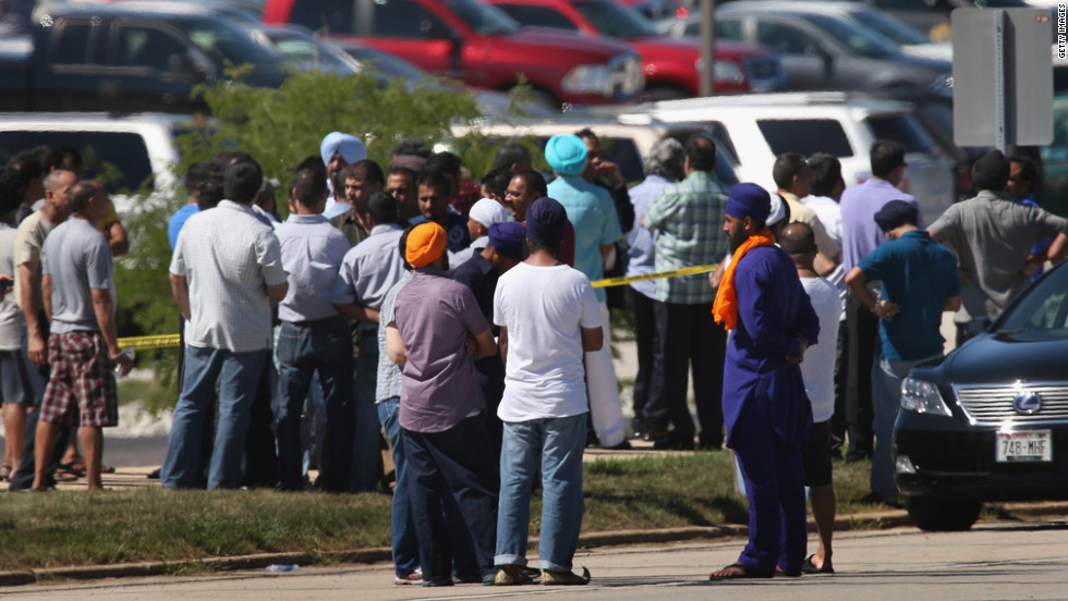 People wait for word on family and friends in front of the Sikh temple. The Oak Creek temple, or gurdwara, opened in 2007.