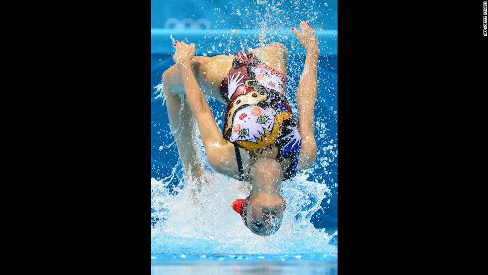 Russia's Svetlana Romashina competes in the duets free routine preliminary round during the synchronized swimming competition.
