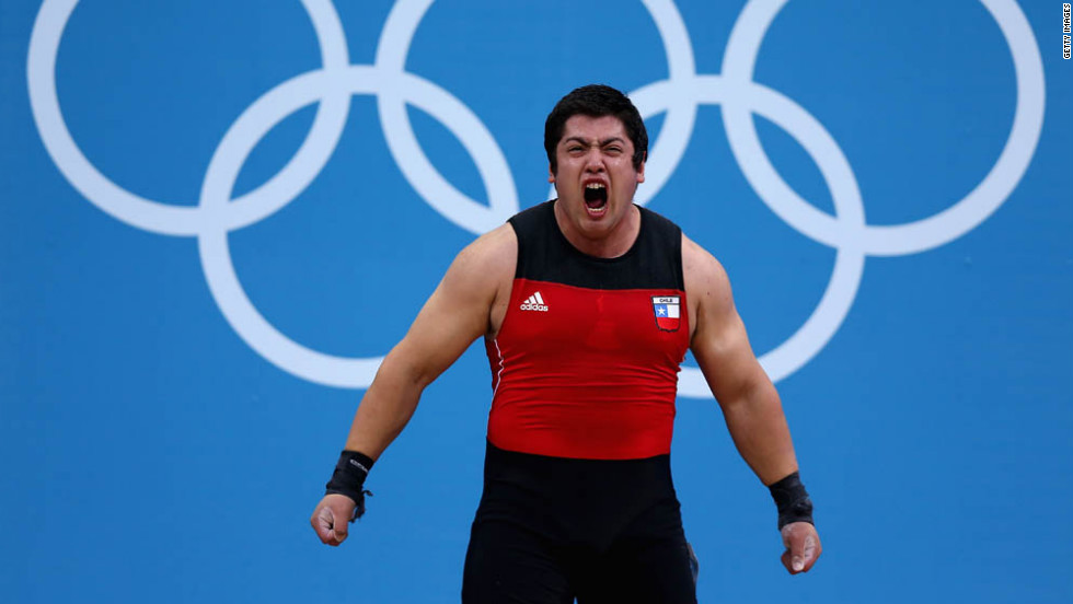 Jorge Eduardo Garcia Bustos of Chile shows his enthusiasm in the men's 105-kilogram weightlifting event.