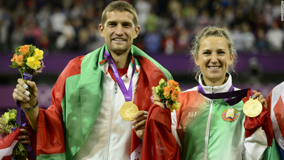 Belarus' Victoria Azarenka (L) and Max Mirnyi display their gold medals at the mixed doubles tennis tournament on August 5.