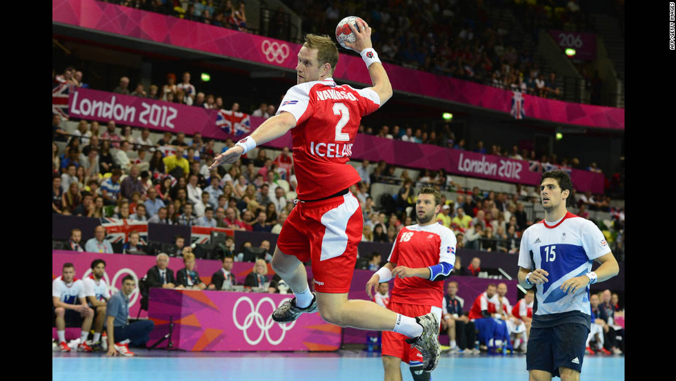 Iceland pivot Vignir Svavarsson jumps to shoot during the men's preliminary Group A handball match against Great Britain. Iceland won 42-24.