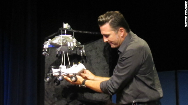 NASA engineer Adam Steltzner demonstrates the rover landing process at the Jet Propulsion Laboratory.
