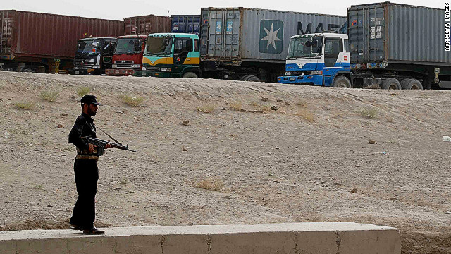 A guard protects container trucks carrying NATO supplies in Chaman, on Pakistan's border with Afghanistan.