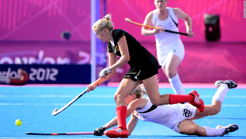 Kristina Hillmann, in black, of Germany challenges Charlotte Harrison of New Zealand during the women's field hockey preliminary round match at the Riverbank Arena on Monday.