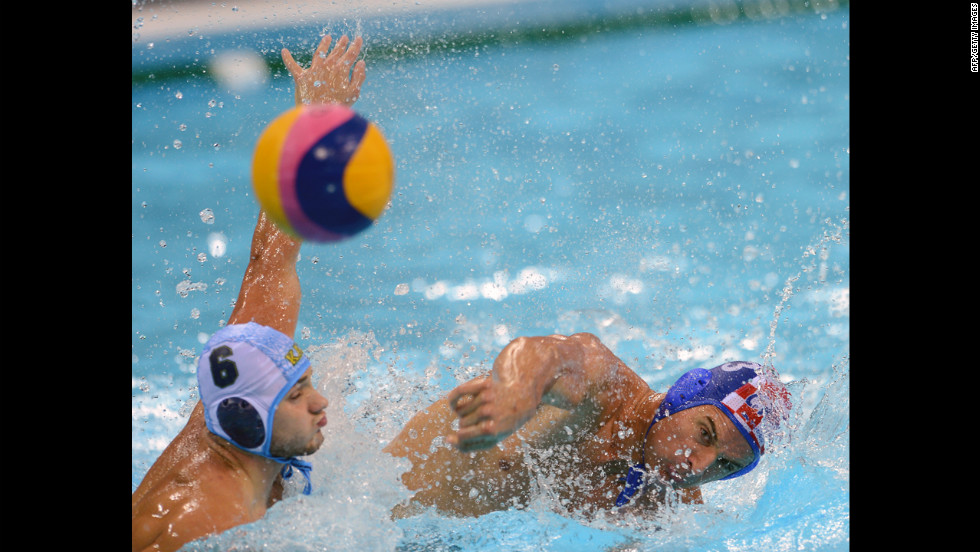 Croatia's Miho Boskovic, right, challenges Kazakhstan's Alexey Shmider during the men's water polo preliminary round Group A match.