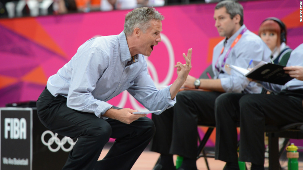 Australian coach Brett Brown shouts instructions to his players during the game against Russia.