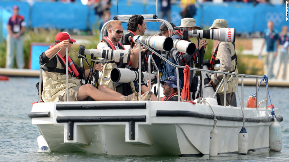 Photographers stake out on a boat for the canoe and kayak sprint.