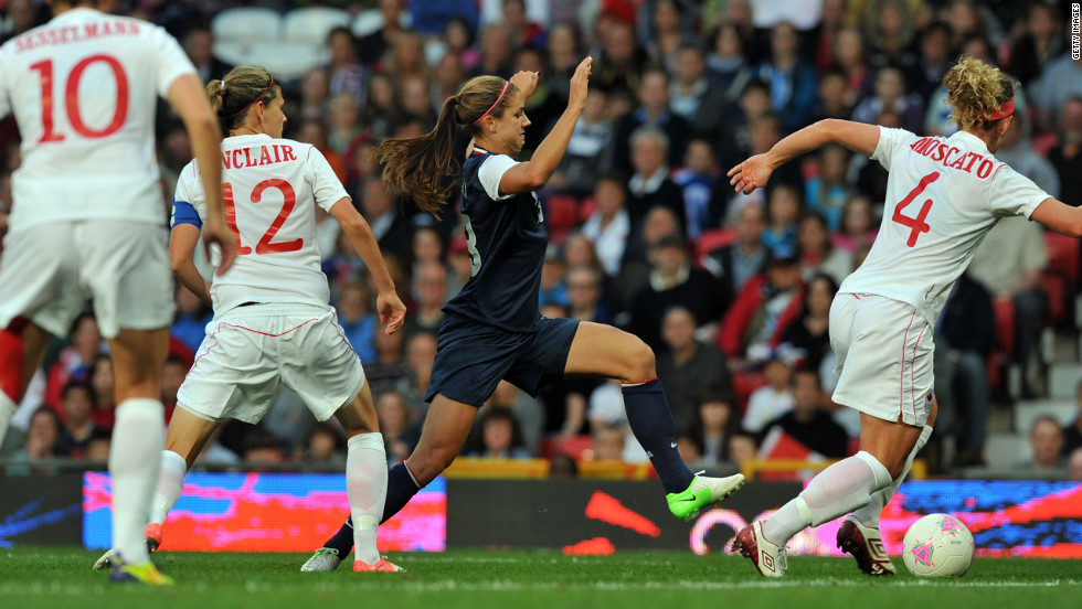 "U.S. forward Alex Morgan, center in blue, runs with the ball past Canada's defender Lauren Sesselmann, number 10,  forward Christine Sinclair, number 12, and defender Carmelina Moscato, number four, during the women's soccer semifinal match on Day 10 of the London Olympic Games on Saturday, August 4.  Check out <a href=""http://www.cnn.com/2012/08/05/worldsport/gallery/olympics-day-9/index.html"" target=""_blank"">Day 9 of competition</a> from Sunday, August 5."