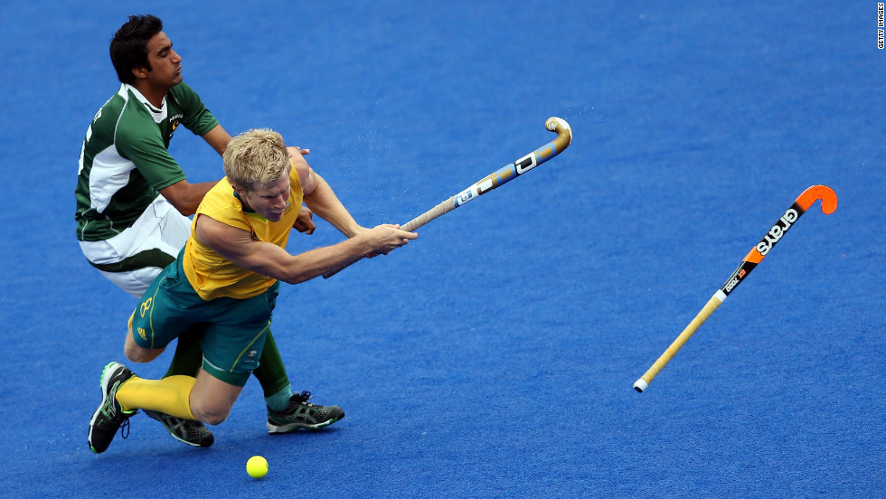 Shafqat Easool of Pakistan, left, fouls Matthew Butturini of Australia during a men's hockey preliminary match.