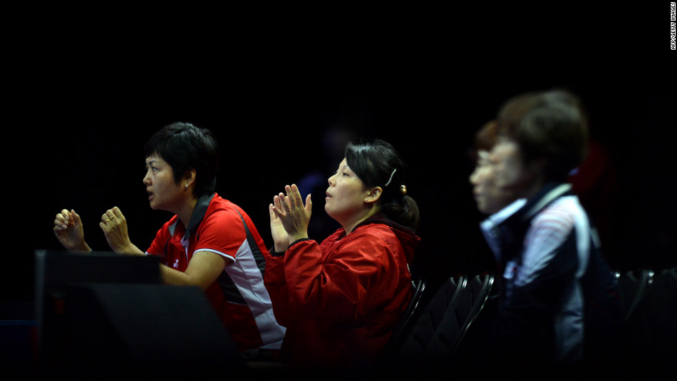 Singapore's team members celebrate a point made by Feng Tianwei against South Korea's Kim Kyungah during the women's team table tennis bronze medal match.