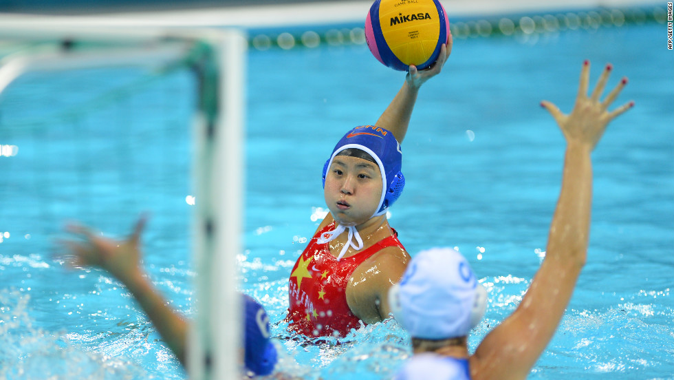 Chinese water polo player Sun Yujun prepares to shoot a goal against Italy during the women's water polo classification match.
