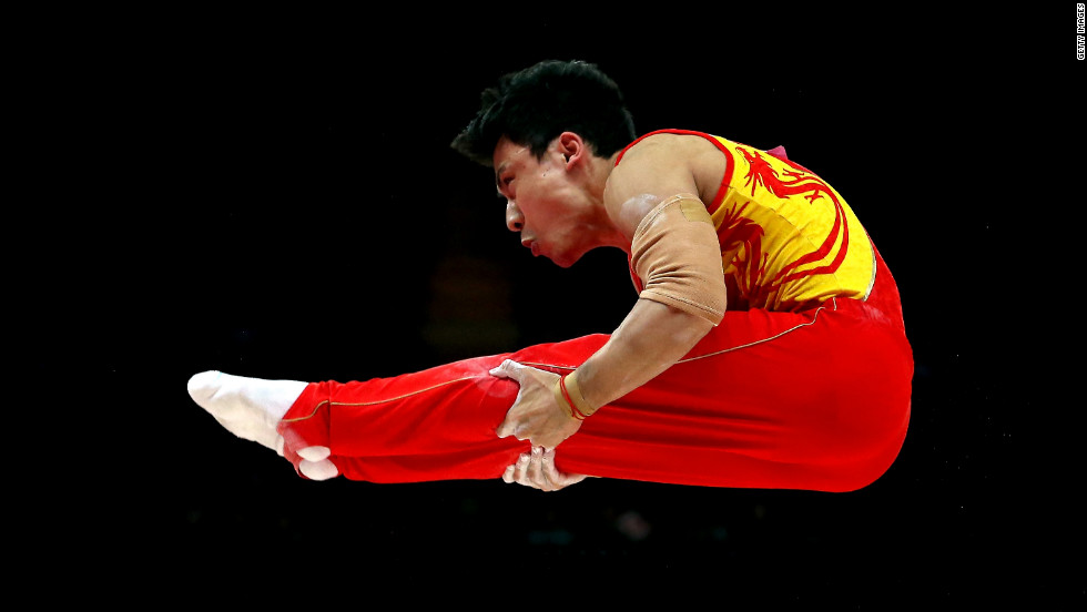 Chinese gymnast Zhe Feng competes on the parallel bars during the finals.