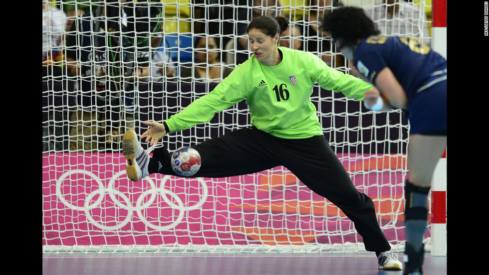 Croatian goalkeeper Ivana Jelcic attempts to block a goal during the women's quarterfinal handball match against Spain. Spain won 25-22.