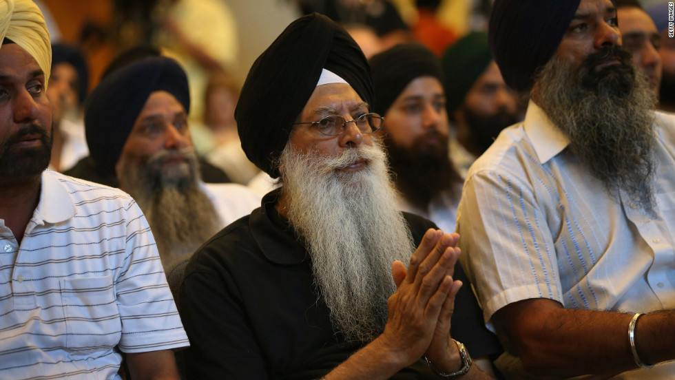 Members of the Miwaukee-area Sikh community gather to learn information about the shooting spree of Wade Michael Page, 40, on Monday, August 6 in Oak Creek, Wisconsin.