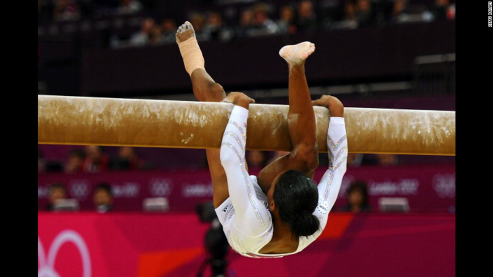 American gymnast Gabrielle Douglas falls off the beam during the women's beam final.