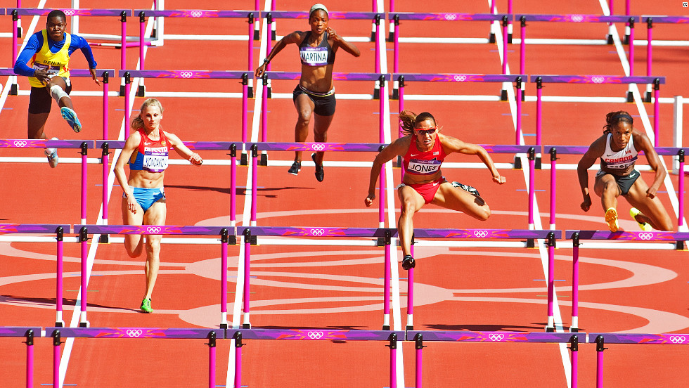 American Lolo Jones cruises through the heats of the women's 100 meter hurdles event at the Olympic Stadium.