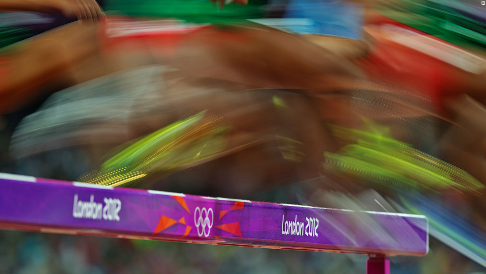 Competitors leap over an obstacle in the women's 3000m steeplechase final, which was won by Russia's Yuliya Zaripova.