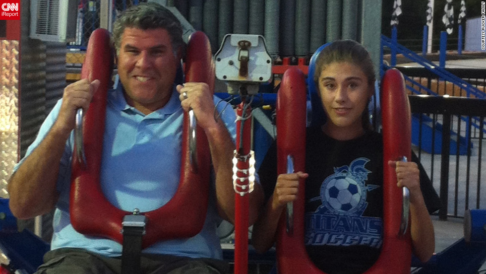 Mission accomplished: Rucker and his daughter ride the Sling Shot in Gatlinburg in June.