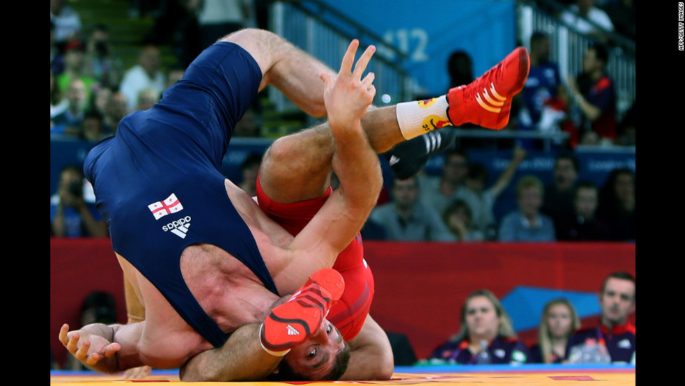Georgia's Manucher Tskhadaia, left, wrestles Hungary's Tamas Lorincz during the 96-kilogram Greco-Roman semifinal on Tuesday.
