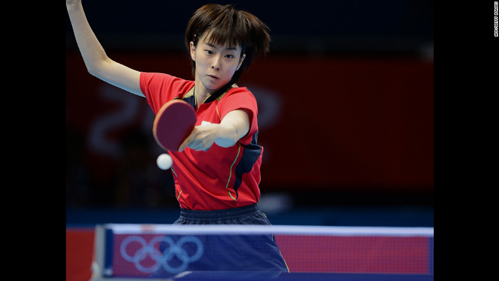 Japan's Kasumi Ishikawa returns the ball to China's Ding Ning during the women's team table tennis gold medal match.