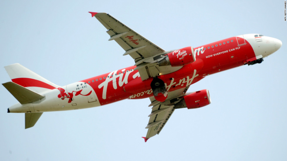 The AirAsia crew didn't notice the error until after the plane became airborne, an Australian report says.