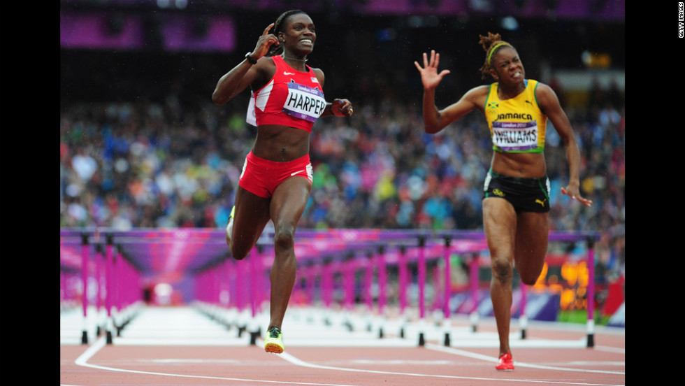Dawn Harper of the United States leads Shermaine Williams of Jamaica in the women's 100-meter hurdles semifinals.
