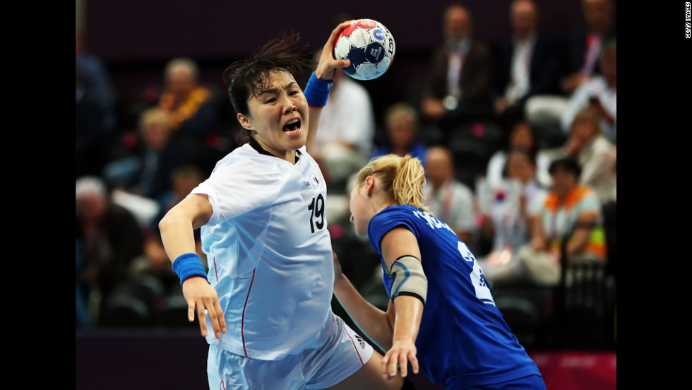 Im Jeong Choi, No. 19 of Korea, shoots over Olga Chernoivanenko, No. 29 of Russia, during the women's quarterfinal match between Russia and Korea on Tuesday.