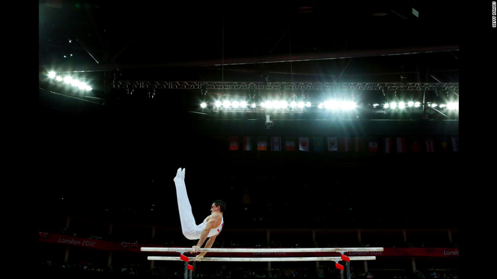 Hamilton Sabot of France competes on the parallel bars during the gymnastics men's parallel bars final.