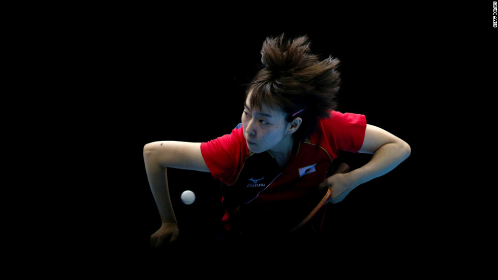 Kasumi Ishikawa of Japan competes against Ning Ding of China during the women's team table tennis gold medal match.