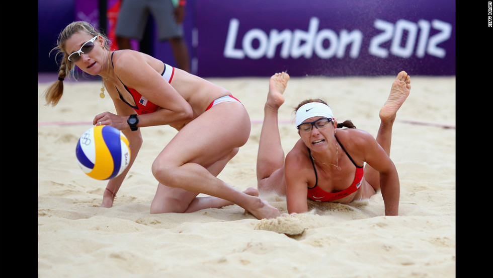 Kerri Walsh Jennings and Misty May-Treanor of the United States collide during the women's beach volleyball semifinal match between United States and China.