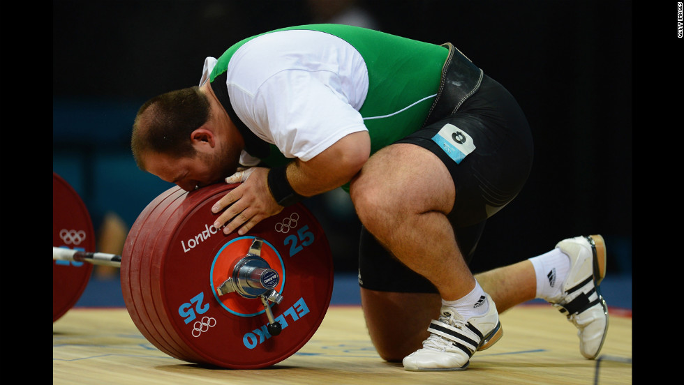 Peter Nagy of Hungary misunderstands sport, attempts to roll barbell.