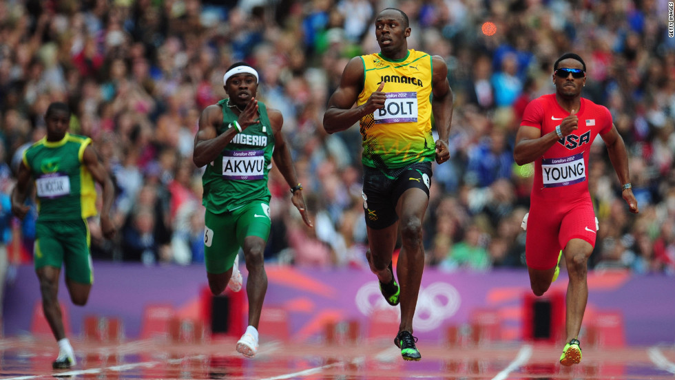 Usain Bolt of Jamaica leads Noah Akwu of Nigeria and Isiah Young of the United States in the men's 200-meter round qualifier on day 11 of the London 2012 Olympics at Olympic Stadium on Tuesday, August 7.