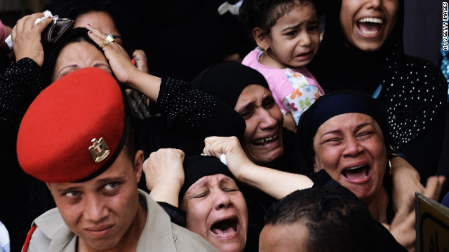 On  August 7, 2012, relatives mourn one of the 16 soldiers killed during an attack on a border crossing post in Northern Sinai.