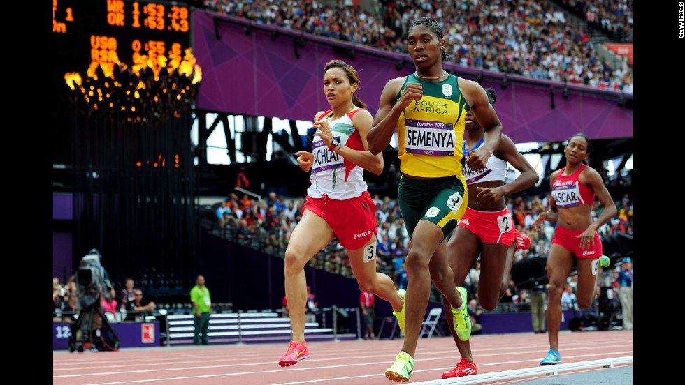 Morocco's Halima Hachlaf, left, and Caster Semenya of South Africa compete in round one of the women's 800-meter heats.