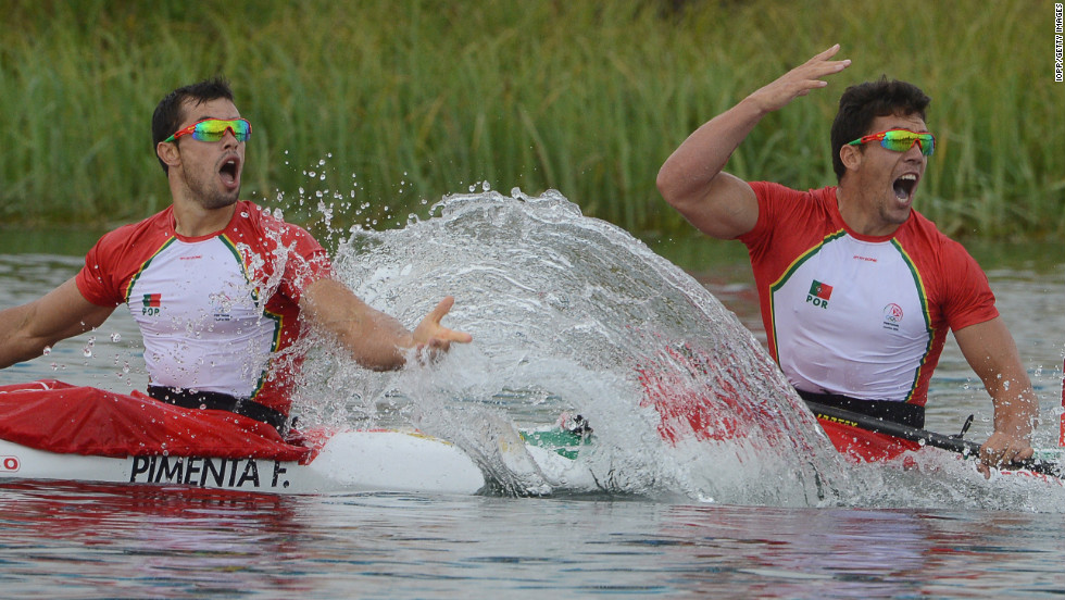 Portugal's Fernando Pimenta, left, and Emanuel Silva celebrate winning the silver medal during the men's kayak double 1,000-meter canoe sprint finals in Windsor, England.