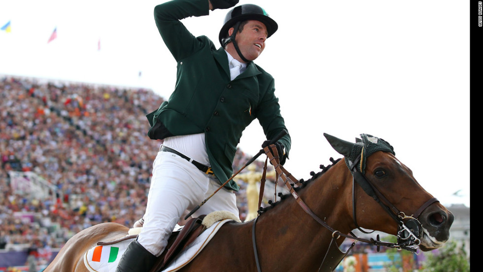 Ireland's Cian O'Connor riding Blue Loyd 12 celebrates winning the bronze in the individual jumping equestrian event.