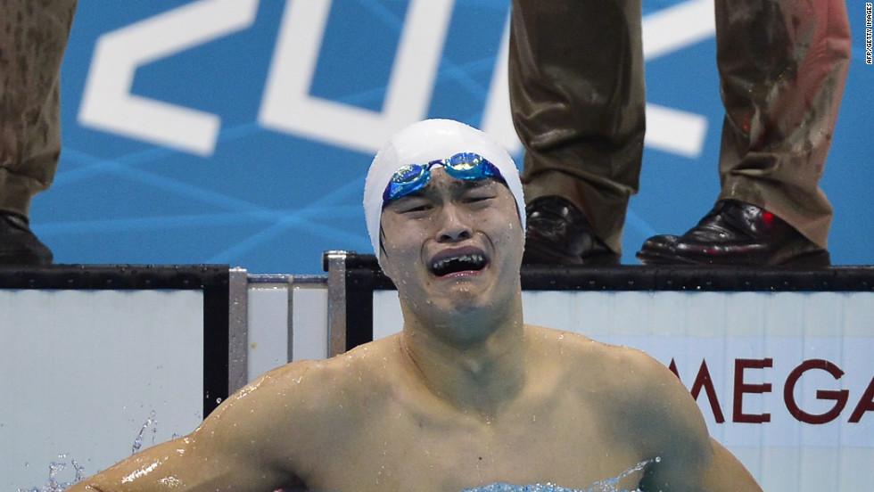 China's Sun Yang couldn't wait to get out of the pool to celebrate his gold medal win in the men's 1,500-meter freestyle.